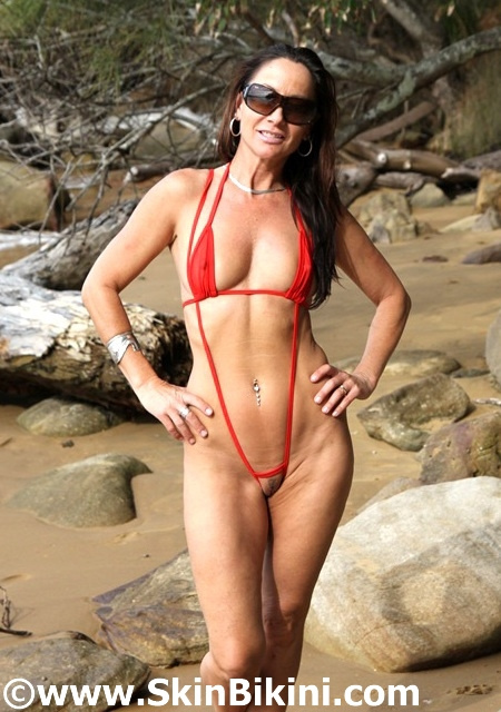Naughty slintshot bikini reversible front in red by skinbikini
